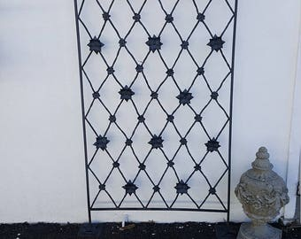 Hand forged garden trellis screen in steel (wrought iron), riveted with flowers, rosettes.  Handmade in Bucks County, Pennsylvania.