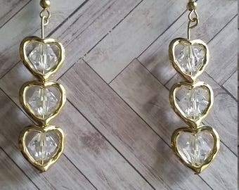 Three tier gold heart earrings with a clear acrylic beads