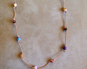 Multi-Colored Beads on Leather Cord necklace