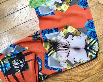 At the beach, printed silk scarf has fringes