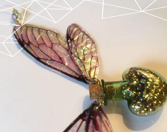 Green heart glass bottle with iridescent insect fairy dragonfly wings