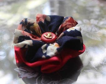 Floral pattern and red fabric flower with nautical themed button