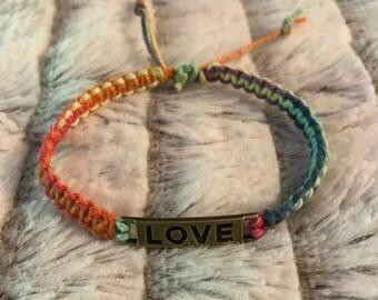 Multi color hemp bracelet with love charm