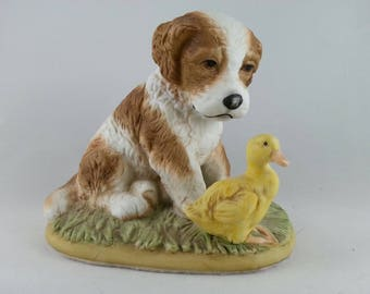 Homco dog with duck. Collectable trinket sculpture.