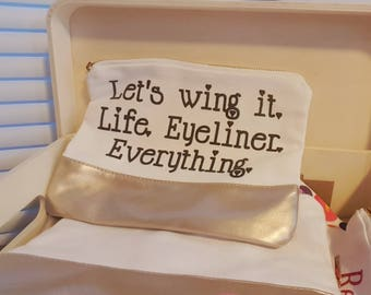 "Makeup Bag - ""Let's wing it. Life. Eyeliner. Everything."" - White and gold"