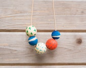 Hand Painted Wooden Bead Necklace in Sugar Cookie,  Anna Joyce, Portland, OR.