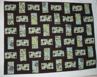 Brown and green polka dot lap quilt