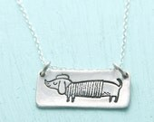 ON SALE L'Artiste Wiener Dog necklace, illustrated by Gemma Correll, eco-friendly silver or white bronze.  Handcrafted by Chocolate and Stee