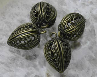 Four fine vintage brass filigree drops or charms..
