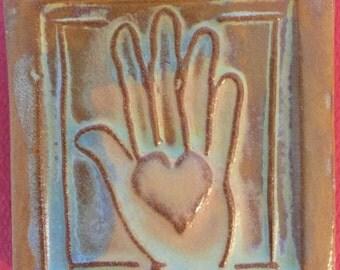 Heart in hand handmade earthenware tile by tilesmile