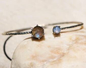 Round faceted labradorite and blue star sapphire cuff bracelet with sterling silver oxidized texture band