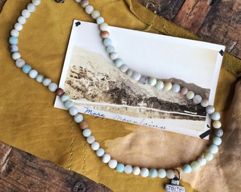 Touch medic cross necklace with frosted Peruvian Opal
