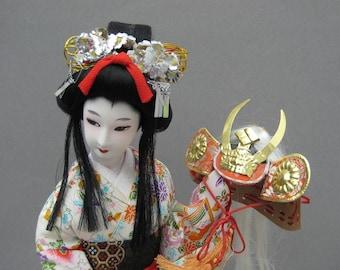 Vintage Japanese Geisha Doll in Silk Kimono Holding Shogun Samurai Warrior Helmet 17.5 Inches Tall