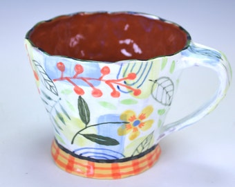 Cup, large, pastel with checks.
