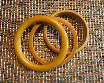 stack of bangles bakelite 3 one spacer one rounded and one flatter edge  bracelets old butterscotch gold