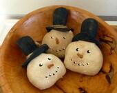 Primitive Snowman Ornies tucks bowl fillers with Santa hat