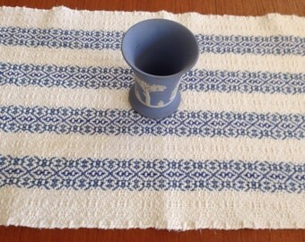 Handwoven table runner , natural with blue stripes
