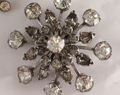 Two extremely cool mid century clear crystal rhinestone atomic floral snowflake brooch pins