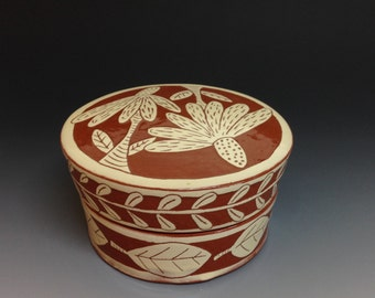 Lidded Jar with Sgraffito Flower Decoration.  Earthenware Pottery