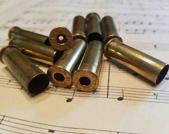 10 spent shell casings 38 caliber primer removed