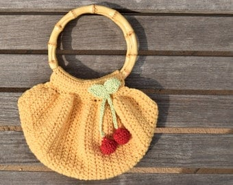 Céret Purse | Handmade Crochet Handbag Dandelion Yellow Wool Cherries and Bow Pin Accent Round Bamboo Handle Vintage Lining - Ready to Ship