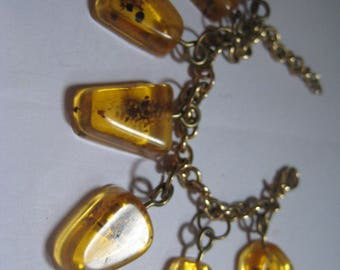 Amber Charm Bracelet with Seven Charms Reconstituted from Natural Amber???