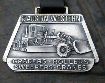 Vintage Austin Western grader watch fob on leather strap medallion advertising fob silver metal
