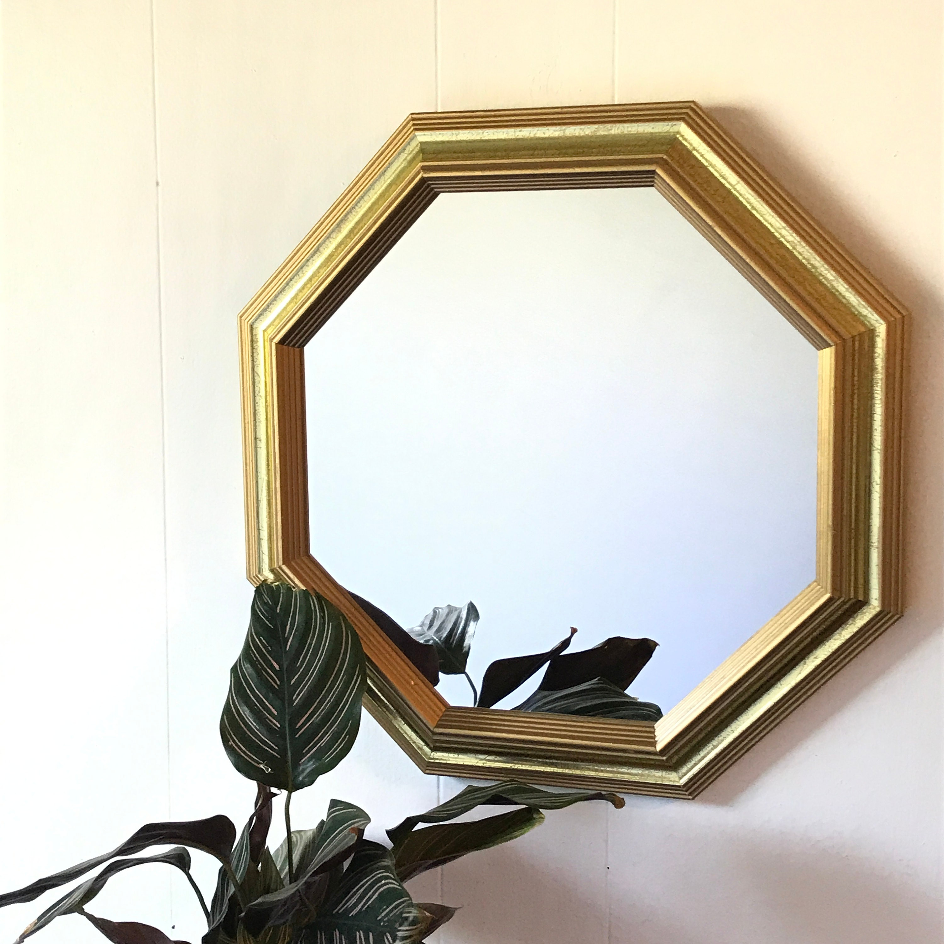 I always use mirrors in my decorating - they add depth and light in a space.