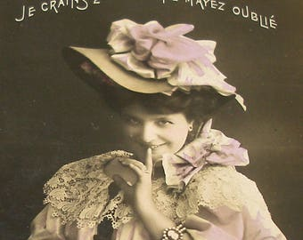 1900s French postcard, Lady with a secret, RPPC real photo postcard.