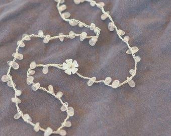 mother-of-pearl blossom on quartz petal strand