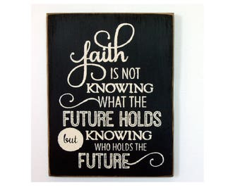 Faith is not knowing what the future holds but knowing who holds the future wood sign