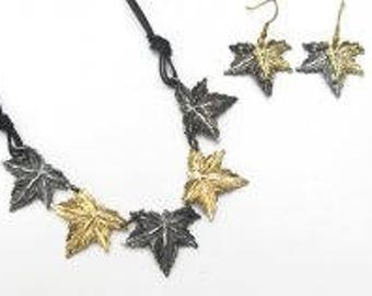Beautiful pewter leaf necklace and earrings. gold and silver tones.  Earthy and beautiful.