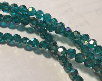 Teal AB faceted crystals