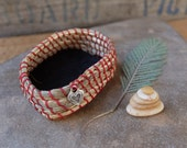 "Basket hand woven from desert grass, eucalyptus wood - ""being mindful & balanced"" with little stone cairn"
