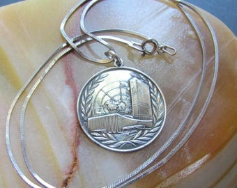 Vintage United Nations Sterling Silver Pendant or Medal made by Bell Trading Company, United Nations Sterling Silver Pendant