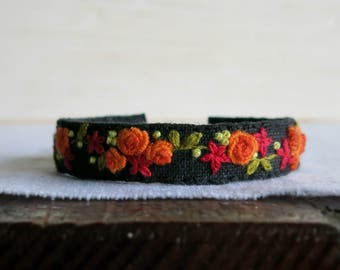 Textile Art Floral Embroidered Bracelet - Orange Red and Green Floral Design on Black Linen Embroidered Cuff Bracelet