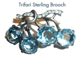Trifari Sterling Silver Blue Rhinestone Brooch. Vintage Pin Circa WWII Era 1940s. Rose Gold Wash over Silver. Gorgeous. All Stones Present.