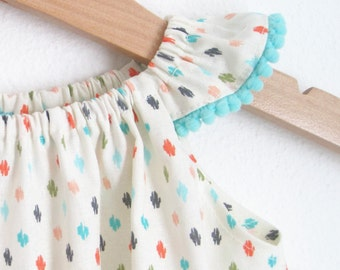 Polka Dotted Baby Dress, infant party dress // ikat cotton baby sundress with aquapompom trim // flutter sleeve dress // baby polkadot dress