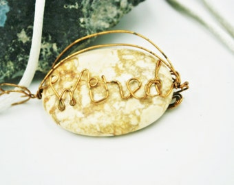 Wired Bronz Name on Tan Magnesite