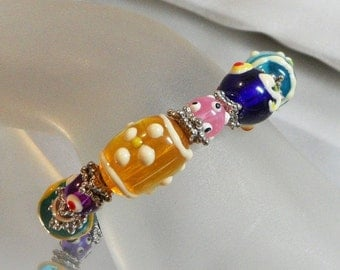 CHRISTMAS SALE Vintage Art Glass Bracelet. Glass Beads. Handmade Beads. Candy. Blue. Yellow. Pink. Purple. Easter. Spring.
