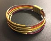 leather wrap bracelet, autumn colors, fall accessories, autumn trends, shown with antique gold tubes
