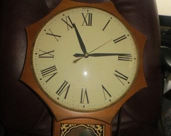 1960   LARGE  Clock,  model 597 Large  Mid Century Pendulum Clock  United Clock Company  Works good