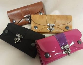 Leather triple pocket purse with swing clasp