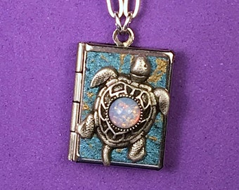 Sea Turtle Peace Book, aquamarine & silver, containing words for peace from around the world