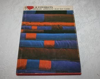 "Vintage Hardcover Book with Dust Jacket "" Quilt and Coverlets "" A Contemporary Approach By Jean Ray Laury 1970"