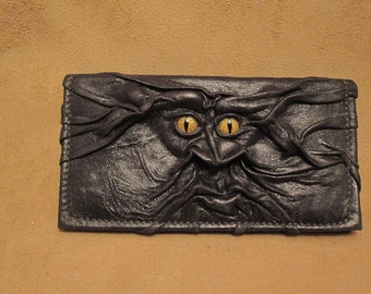 "Grichels leather checkbook cover - ""Tregrach"" 28773 - black with gold speckled slit pupil reptile eyes"