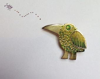 green bird brooch