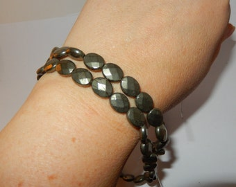 "Pyrite faceted oval beads - 16"" strand"