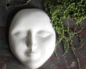 vintage white face, art display