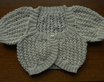 Cardigan/bolero/shrug for a girl age approx 6-7 yrs, chest 24/26 in.  Hand knitted in cream/ivory soft cotton yarn. ? suitable for wedding